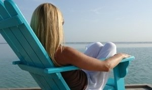 blonde in adirondack chair
