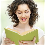 happy woman reading green book
