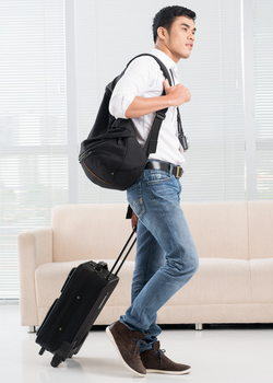 young man with carry on bags