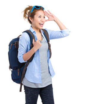 woman dressed casually for travel with carry on backpack