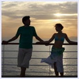 couple aboard cruise ship at sunset