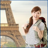 Woman with backpack at Eiffel tower