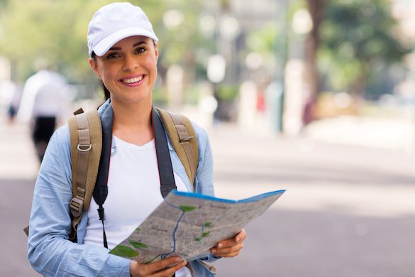 Female backpacker with map and camera