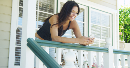 woman on front porch of home that she's house sitting