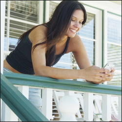 woman on front porch of house sit
