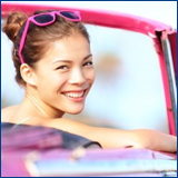 smiling woman pink car