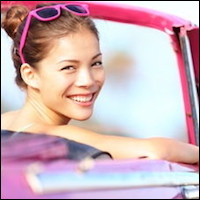 Young woman in hot pink car
