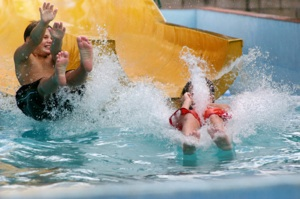 kids emerging from waterslide