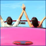 happy couple pink convertable
