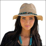 beautiful woman wearing a packable straw hat=