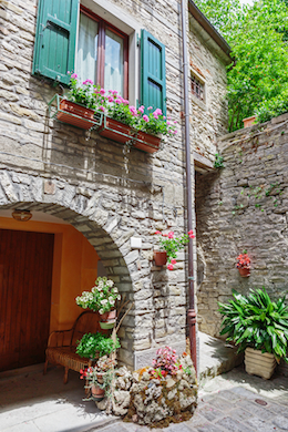 stone wall and entrance in tuscan neighborhood