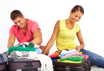 Young man and woman packing for vacation