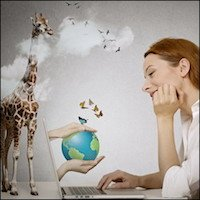 Woman dreaming of vacation at laptop with giraffe in background