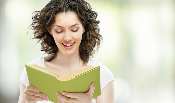 happy woman reading book on vacation