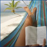woman in hammock reading book, palm tree