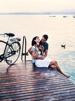 couple on dock with bike
