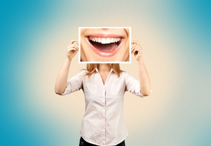 woman holding up big smile