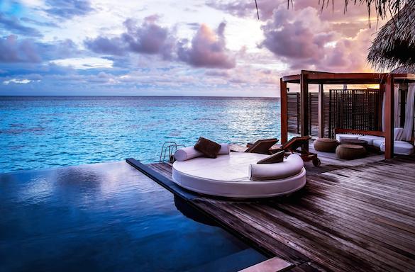 deck and infinity pool overlooking water
