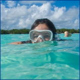 woman wearing a snorkel mask