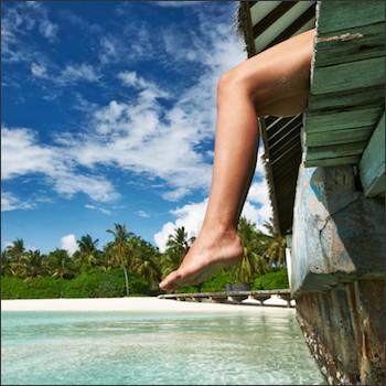 legs dangling over dock