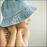 little girl wearing a packable denim hat