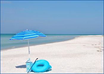 umbrella, bag and swim ring on beach