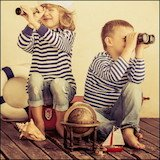 boy and girl with binoculars