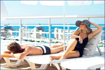couple poolside on cruise ship deck