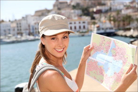 young woman traveler holding a map