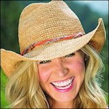 smiling.woman wearing wallaroo packable sun hat